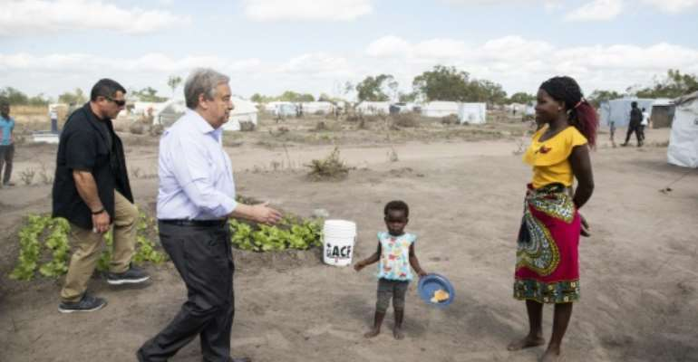 Guterres met people living at a resettlement camp in cyclone-hit central Mozambique.  By WIKUS DE WET (AFP)