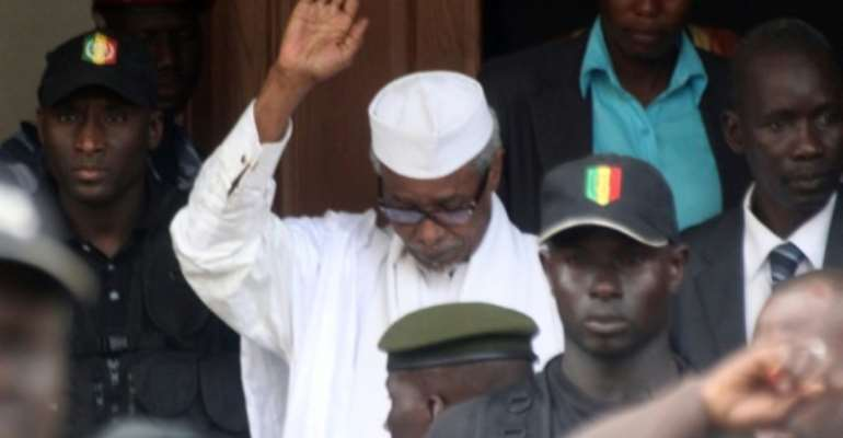 Habre, pictured in 2013 while leaving a court in Dakar. Tens of thousands of Chadians died under his rule, say investigators.  By - (AFP/File)
