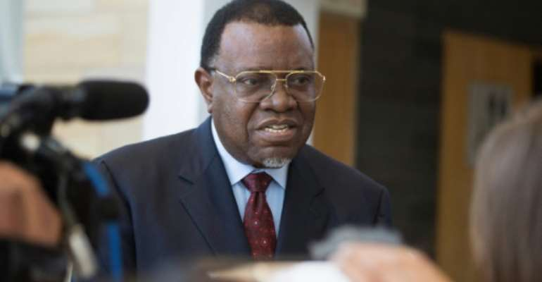 Hage Geingob (pictured September 2019) was declared president of Namibia's vote, retaining his position and the ruling South West Africa People's Organisation's long dominance of power.  By RODGER BOSCH (AFP/File)