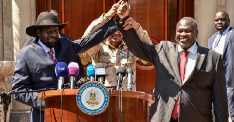 Hands together: South Sudan President Salva Kiir, left, and rebel leader Riek Machar in Juba on December 17 last year.  By Majak Kuany, Majak Kuany (AFP/File)
