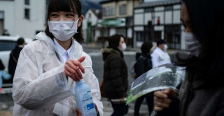 Handwashing and hygiene in Japan has helped push down the number of flu infections this year, officials say.  By Philip FONG (AFP/File)