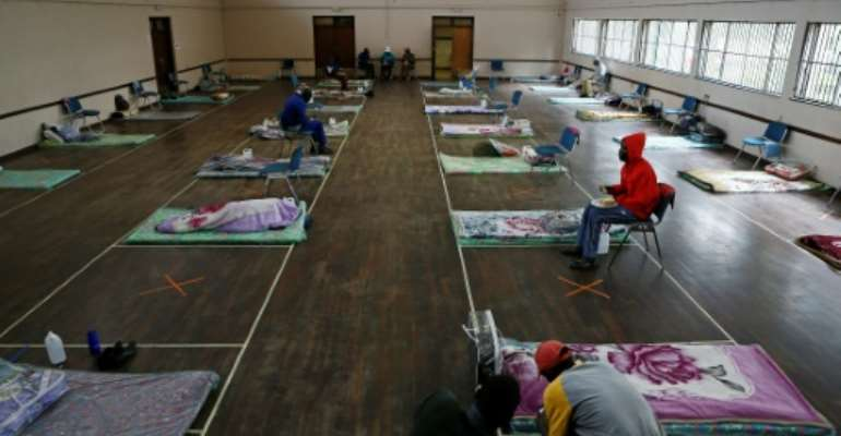 Haven: The Lyttelton Community Hall in Pretoria, one of a number of temporary shelters for the city's homeless during the coronavirus lockdown.  By Phill Magakoe (AFP)