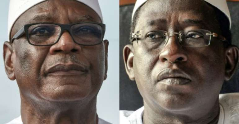 Head to head: Ibrahim Boubacar Keita, left, faces off against opposition leader Soumaila Cisse on Sunday.  By Sia KAMBOU, Issouf SANOGO (AFP/File)