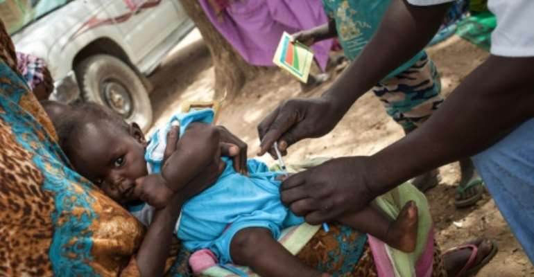 Health workers are doing their best to administer the measles, mumps and rubella vaccine to poor children in eastern Chad.  By Amaury HAUCHARD (AFP)