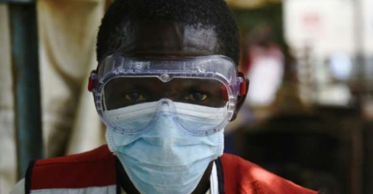 Health workers in Uganda have been carrying out checks after two fatal cases of Ebola near the border with the DR Congo.  By ISAAC KASAMANI (AFP)
