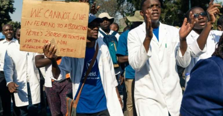 Health workers marched to the Zimbabwean parliament last month to demand the safe return of union leader Peter Magombeyi, who went missing after leading strikes for better pay.  By Jekesai NJIKIZANA (AFP)