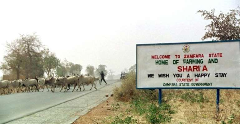 Heavily armed gangs -- called bandits by locals -- have long plagued northwest and central Nigeria by looting, stealing cattle and abducting people for ransom.  By PIUS UTOMI EKPEI (AFP/File)