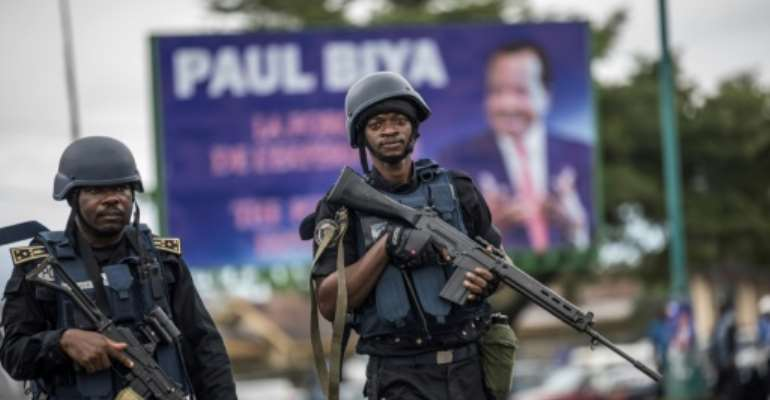 Heavily armed gendarmes  in Buea, capital of Cameroon's South-West region, one of the two territories where separatists took up arms in 2017.  By MARCO LONGARI (AFP/File)