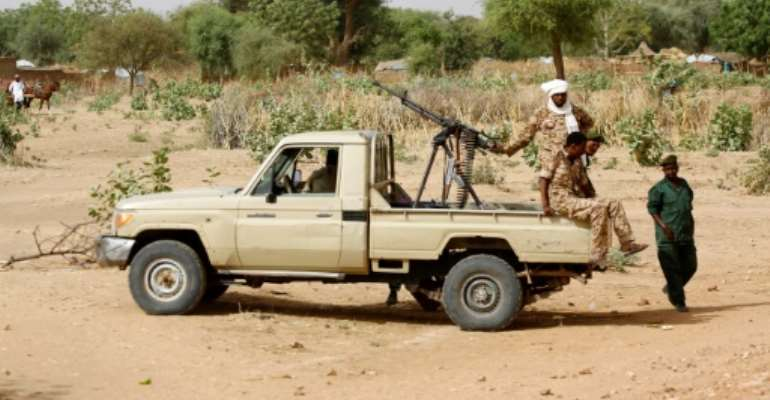 Heavy fighting in Sudan's Darfur has seen over 80 people killed; this photo from April 2016 shows a convoy of Sudanese security forces in El Geneina.  By ASHRAF SHAZLY (AFP/File)