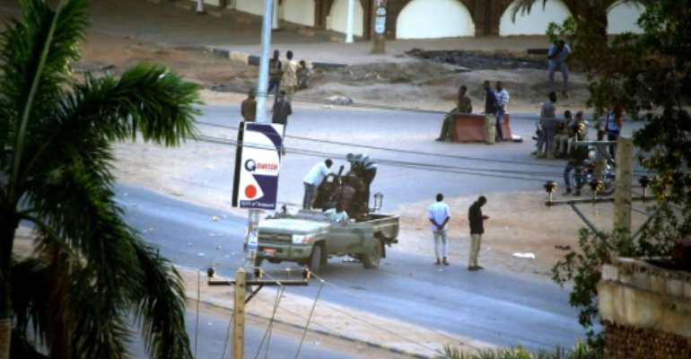 Heavy gunfire broke out in the Sudanese capital as several agents of the long-feared security agency launched a short-lived mutiny.  By ASHRAF SHAZLY (AFP/File)