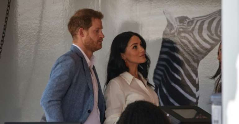 Helping hand: Prince Harry and his wife Meghan, the Duchess of Sussex, at a youth employment hub in Johannesburg.  By Michele Spatari (AFP)