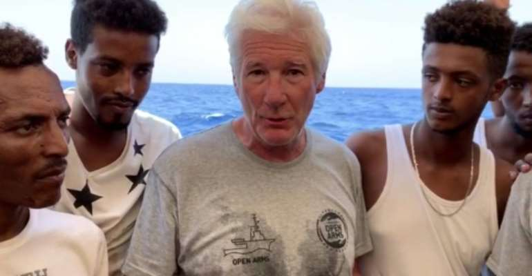 Hollywood star Richard Gere boarded a migrants rescue ship to keep a spotlight on the 121 stranded migrants.  By HO (PROACTIVA OPEN ARMS/AFP)