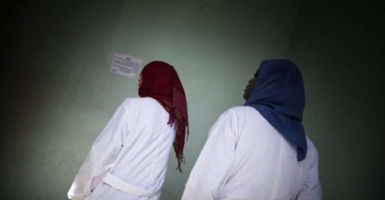 Veiled Libyan nurses are pictured at the Al-Zawiya hospital in Tripoli on October 13, 2011.  By Marco Longari (AFP/File)