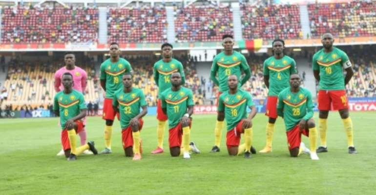 Hosts Cameroon pose before defeating Zimbabwe last Saturday in the African Nations Championship opener..  By - (AFP)