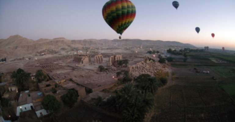 Hot air balloons fly above Egypt's Valley of the Kings, near Luxor in 2007.  By CHARLES ONIANS (AFP/File)