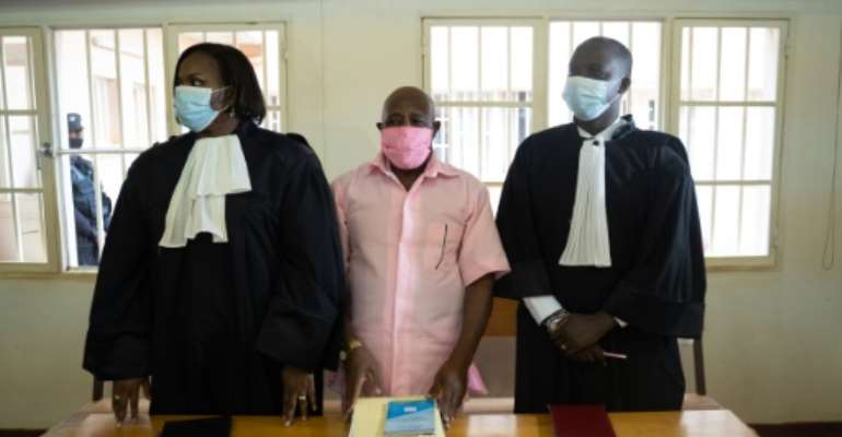 'Hotel Rwanda' hero Paul Rusesabagina, centre, pictured last October at his trial in Kigali.  By Simon Wohlfahrt (AFP)