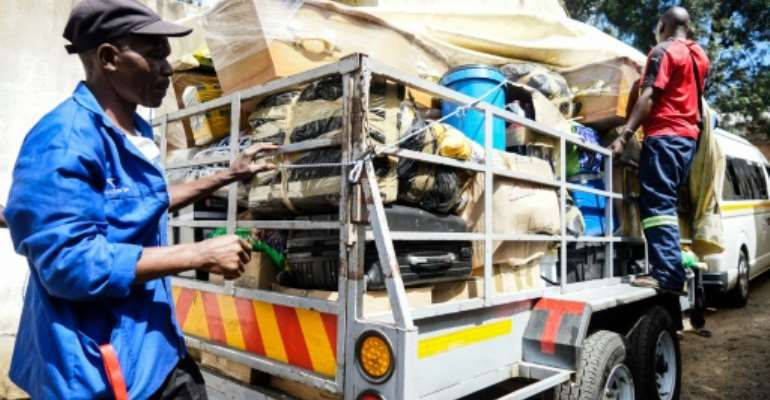 Household essentials have become in short supply in Zimbabwe as the economic situation has worsened, driving a cross-border delivery service from South Africa.  By ZINYANGE AUNTONY (AFP)
