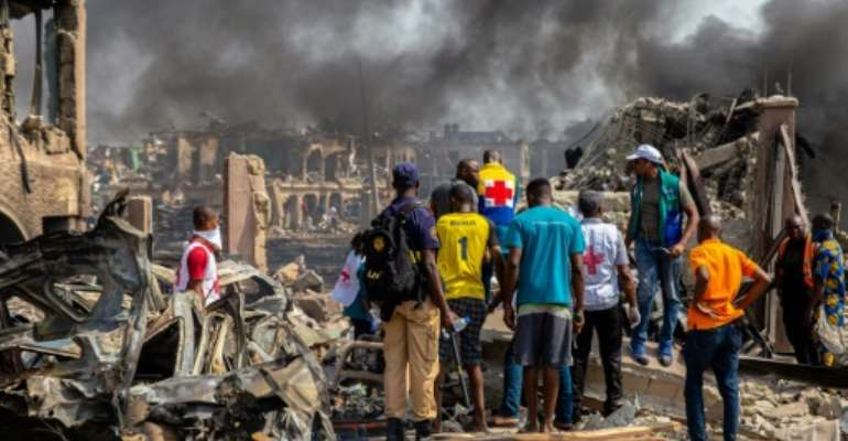 Houses, lorries, cars and motorbikes were torched in the blast.  By Benson IBEABUCHI (AFP)