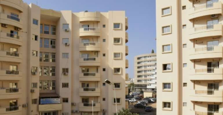 Housing boom: New apartment blocks are being built in Dakar, but spiralling rents make living there a distant dream for many.  By Seyllou (AFP)