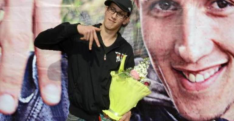 Mouad Belghawat, aka Lhaqed, a young Moroccan rapper known for his anti-monarchy lyrics, poses for a photo during a press conference after he was released from jail in Casablanca on March 29, 2013.  By Fadel Senna (AFP/File)