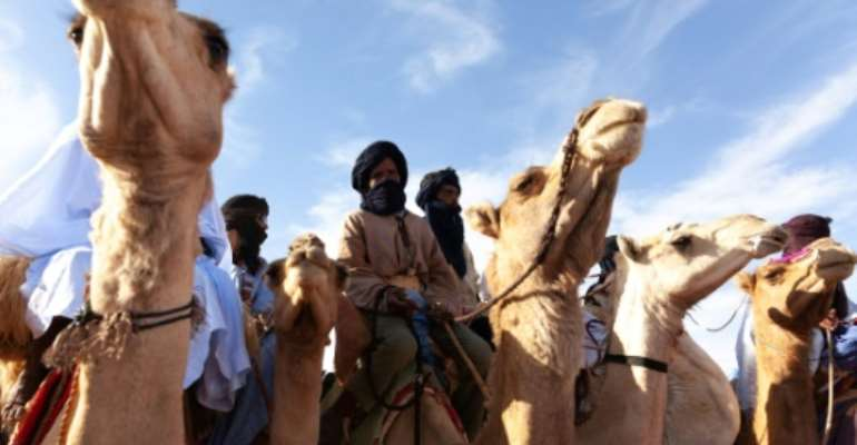 Humps on the stump: Camel-riding supporters attend a UPR rally in Chinguetti, an ancient Berber trading centre in central Mauritania.  By Carmen Abd Ali, Carmen Abd Ali (AFP)