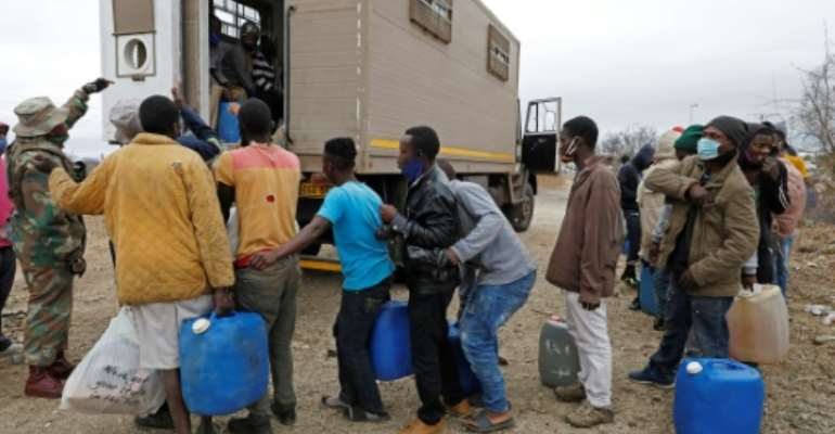 Hundreds have been at arrested at the South African border trying to smuggle groceries and fuel back to Zimbabwe.  By Phill Magakoe (AFP)