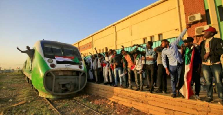 Hundreds of people crammed into a train to the cradle of Sudan's uprising to mark the first anniversary of the start of the protests.  By ASHRAF SHAZLY (AFP)