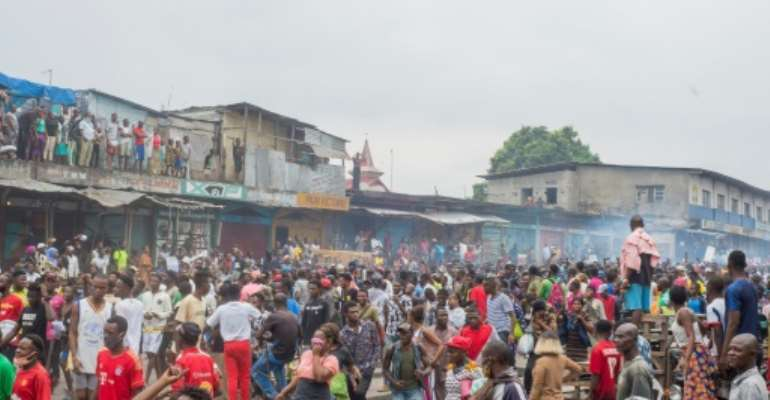 Hundreds of protesters gathered to demand the reopening of the Kinshasa market.  By ARSENE MPIANA (AFP)