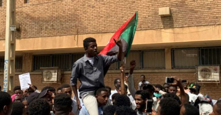 Hundreds of Sudanese university students rallied in downtown Khartoum Tuesday seeking justice for fellow pupils killed in months of political unrest.  By Haitham EL-TABEI (AFP)