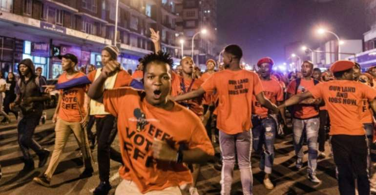 Hundreds of supporters of the opposition radical-left EFF party march in Durban on the eve of the election.  By Rajesh JANTILAL (AFP)