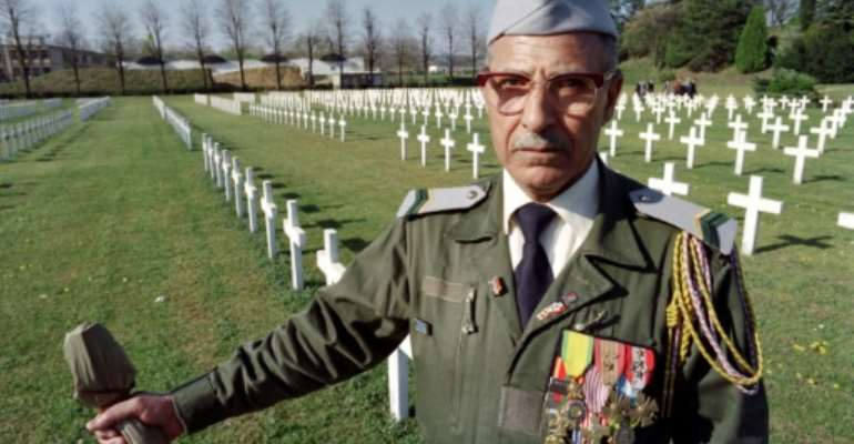 Hundreds of thousands of Algerian Muslims -- known as Harkis -- served as auxiliaries in the French army during the war for Algerian independence.  By Jean-Marie HURON (AFP/File)