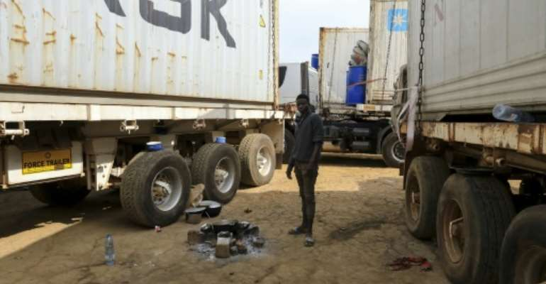 Hundreds of trucks are stuck at the border between Cameroon and the Central African Republic after rebels started to strike the RN1 highway -- the CAR capital's lifeline.  By Daniel Beloumou Olomo (AFP)