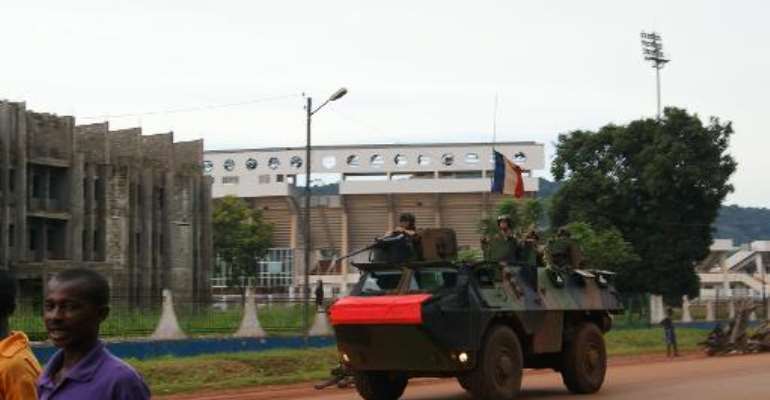 French soldiers patrol a street in Bangui, The Central African Republic on October 23, 2013.  By Pacome Pabandji (AFP/File)