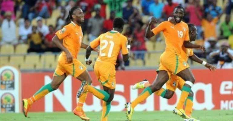 Ivory Coast Midfielder Yaya Toure (R) celebrates after scoring in Rustenburg on January 26, 2013.  By Alexander Joe (AFP)
