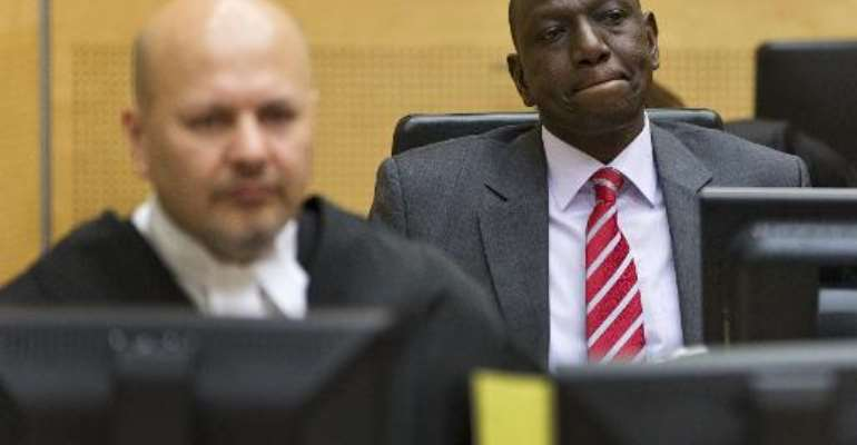 This picture taken on September 10, 2013 shows Kenya's Deputy President William Ruto ( R) in the courtroom at the International Criminal Court (ICC) in The Hague.  By Michael Kooren (Pool/AFP/File)