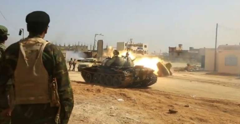 Image from a video published on the Libyan strongman Khalifa Haftar's self-proclaimed Libyan National Army War Information Division's Facebook page on April 16, 2019, shows a tank firing its turret reportedly in a southern suburb of the capital Tripoli..  By - (LNA War Information Division/AFP)