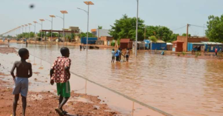 In 2018, heavy rains were blamed for the deaths of 52 people and the destruction of 170,000 homes in Niger.  By BOUREIMA HAMA (AFP/File)