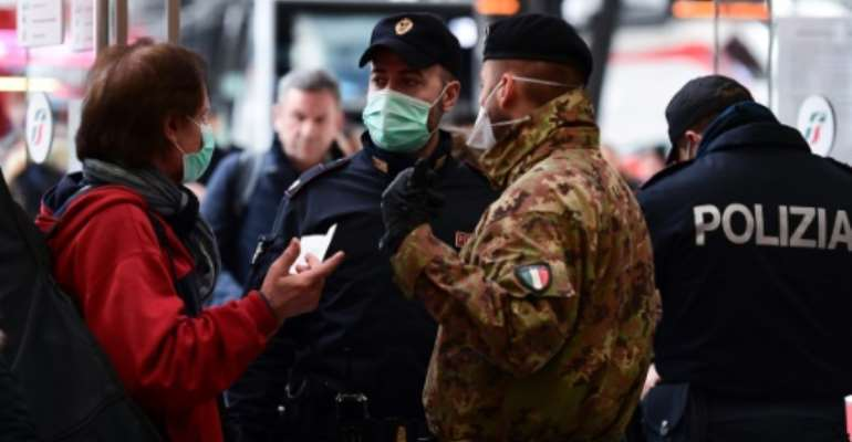 In a desperate bid to stem the spread, Italy's Prime Minister Giuseppe Conte went on television to announce the entire country would effectively be placed on lockdown from Tuesday.  By Miguel MEDINA (AFP)