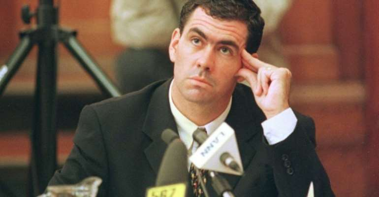 In a fix: Hansie Cronje ponders a point during his cross-examination at the King Commission of Inquiry into allegations of match-fixing in 2000.  By ANNA ZIEMINSKI (AFP/File)