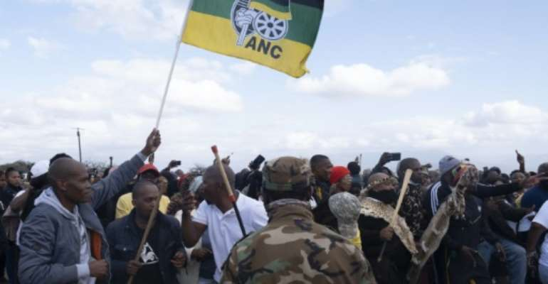 In a show of force, Jacob Zuma loyalists are camped outside their embattled leader's Nkandla homestead in Kwa-Zulu Natal province.  By Emmanuel Croset (AFP)