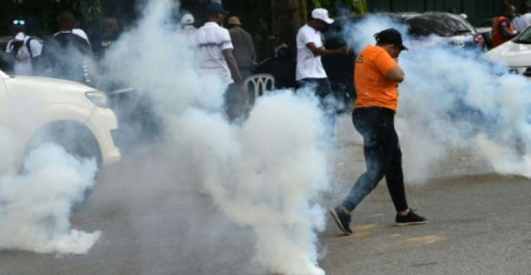 In Abidjan, security forces in uniform and plain clothes stormed Soro's GPS headquarters.  By SIA KAMBOU (AFP)