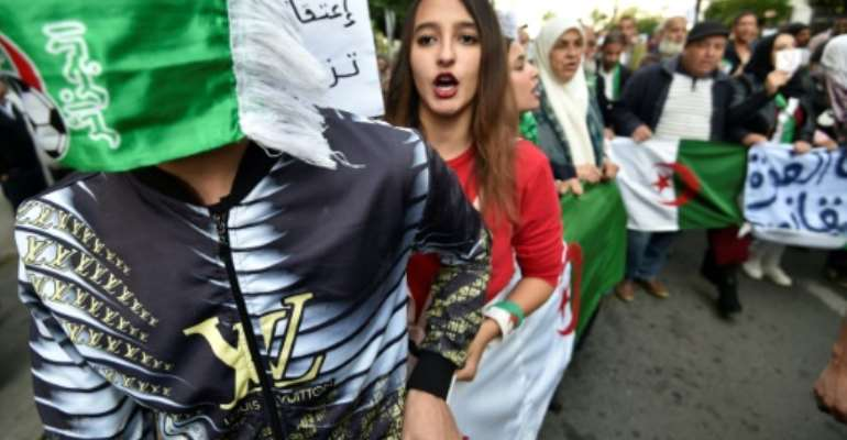 In Algeria, demonstrators are agitating for the cancellation of elections, saying they do not want former regime figures to cement power.  By RYAD KRAMDI (AFP/File)