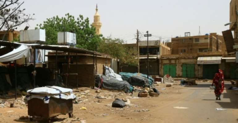 In Khartoum's twin city of Omdurman, across the River Nile, many shops and markets remained closed.  By - (AFP)