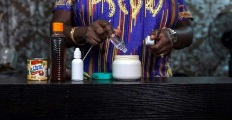 In many countries, skin lightening cream is mixed in beauty saloons or backstreet shops.  By STEFAN HEUNIS (AFP)