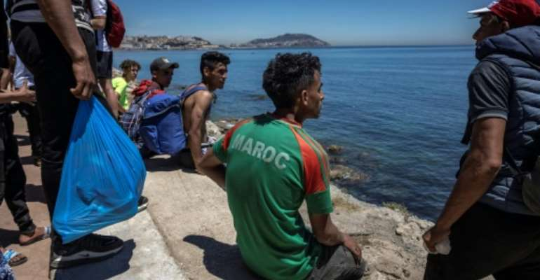 In mid-May, Spain was caught off guard when more than 10,000 people swam or used small inflatable boats to cross into Ceuta territory as the Moroccan border forces looked the other way..  By FADEL SENNA (AFP/File)