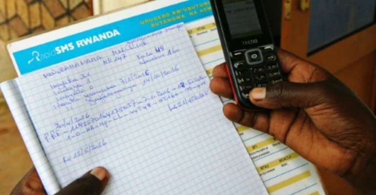A pregnant woman records her information by SMS on the country's