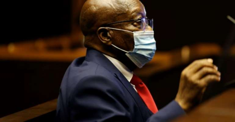 In the dock: Former South African president Jacob Zuma at his corruption trial on Wednesday.  By PHILL MAGAKOE (POOL/AFP)