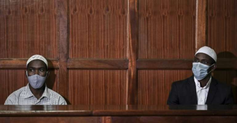 In the dock: Hassan Hussein Mustafa, left, and Mohamed Ahmed Abdi awaiting the verdict on Friday.  By TONY KARUMBA (AFP)