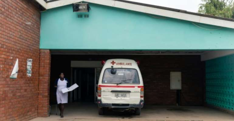 In the southern African country on its knees after two decades of economic misrule, health services are all but extinct.  By Jekesai NJIKIZANA (AFP)