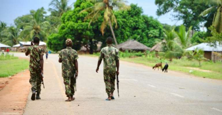 In this file photo taken in March 2018, soldiers from the Mozambican army patrol the streets in Mocimboa da Praia. Three years into a jihadist rebellion, northern Mozambique is still under siege.  By ADRIEN BARBIER (AFP/File)